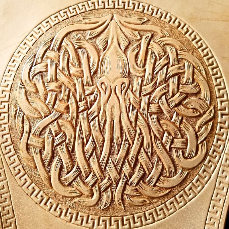 Close up of tooled Celtic squid.